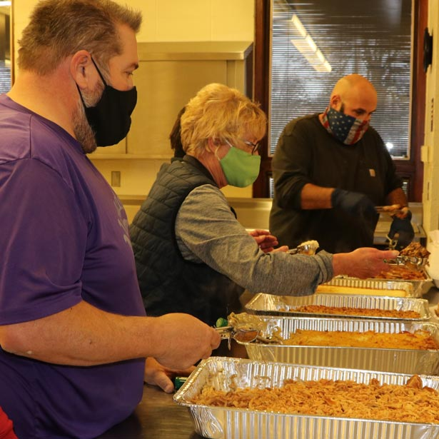 Group serving food at a parks and recreation event